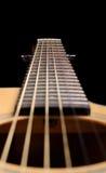 在黑色背景的声学吉他 免版税图库摄影
