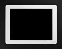 在黑色背景的片剂个人计算机 免版税库存照片