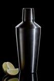 在黑色背景的鸡尾酒搅拌器 免版税库存图片