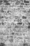 在黑色颜色的砖墙。 免版税图库摄影