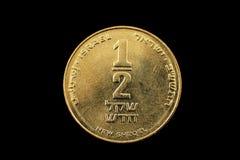 在黑Bacground隔绝的以色列半锡克尔硬币 免版税图库摄影