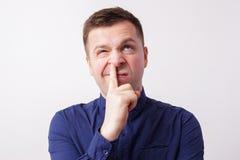 在鼻子的演播室画象白种人人手指 库存照片