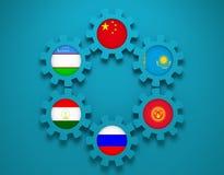在齿轮的上海合作组织成员国旗 免版税库存图片