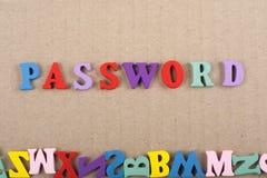 在从五颜六色的abc字母表块木信件组成的木背景,广告文本的拷贝空间的密码词 免版税库存照片