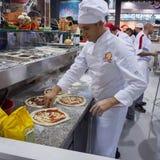 在主人的薄饼2013年在米兰,意大利 库存图片