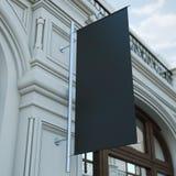 在经典大厦的黑横幅旗子 免版税库存照片