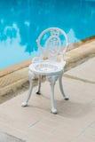 在经典样式的白色钢椅子 免版税库存图片