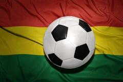 在玻利维亚的国旗的黑白橄榄球球 库存照片