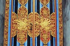 在巴厘岛寺庙门细节的神秘的动物 免版税图库摄影