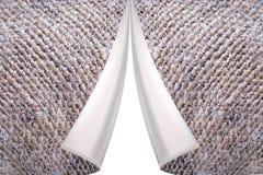 在织品灰色纹理的翻领与袋装的 库存照片