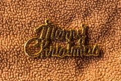 在织品,静物画的圣诞快乐词 库存照片