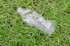 在围场的塑料瓶 免版税图库摄影