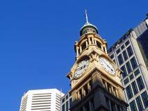 在维多利亚女王时代的时代大厦的Clocktower 免版税库存照片
