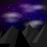 在满天星斗的天空背景的山剪影 库存照片
