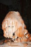 在洞奇怪的石笋形成的氧化钢 库存图片