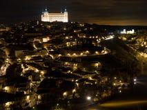在1986年历史的市托莱多由联合国科教文组织宣称世界遗产名录站点 夜视图在托莱多,卡斯蒂利亚拉曼查,西班牙 免版税库存图片