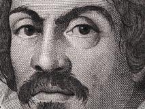 在100000意大利里拉的Caravaggio画象钞票特写镜头macr 免版税库存照片