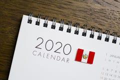 在2020日历的秘鲁旗子 图库摄影
