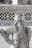在黎明寺佛教寺庙的中国雕象在曼谷 免版税库存图片