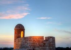 在黄昏期间的被点燃的手表塔 免版税库存照片