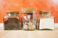 在水晶瓶子的金钱 免版税库存照片