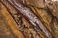 在黑暗和温暖的颜色的自然美丽的大理石 免版税库存图片