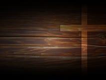 在黑暗的木纹理的十字架 免版税库存照片