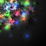 在黑暗的背景的五颜六色的发光的光亮星 库存图片