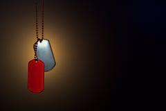 在黑暗的背景的军事ID标记 免版税库存图片