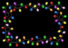 在黑暗的背景的圣诞灯与文本的空间 库存照片