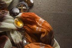 在黑暗的背景的橙色纺织品 库存图片