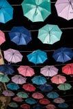 在黑暗的背景的色的开放伞 免版税库存图片