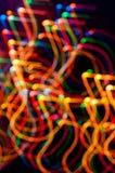 在黑暗的背景的色的freezelight 图库摄影