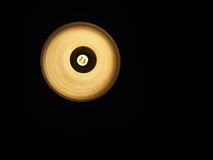 在黑暗的背景的节能光 免版税图库摄影