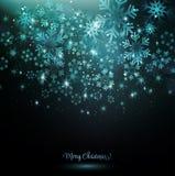 在黑暗的背景的蓝色雪花 免版税库存图片