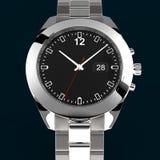 在黑暗的背景的银色手表 免版税库存照片
