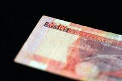 在黑暗的背景的100香港美元 免版税库存图片