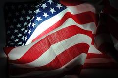 在黑暗的TAmerican旗子 免版税库存图片