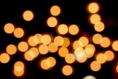 在黑暗02的橙色bokeh 库存照片