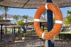 在晴朗的海滩的Lifeboy 库存图片
