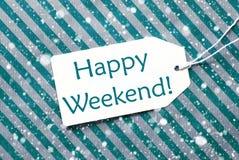 在绿松石纸,雪花的标签,发短信给愉快的周末 库存图片