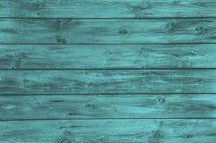 在绿松石颜色的老木被绘的背景 免版税库存图片