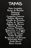 在黑板写的塔帕纤维布菜单,西班牙 图库摄影