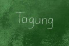 在黑板写的Tagung 免版税库存图片