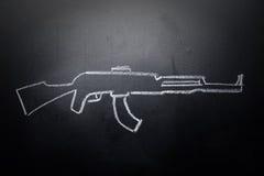 在黑板删掉的武器凹道-没有暴力概念 免版税库存照片
