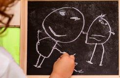 在黑板的女孩图画 图库摄影