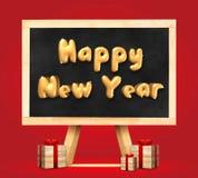 在黑板的新年好和礼物盒3d翻译有ea的 库存照片
