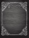在黑板的葡萄酒框架。 免版税图库摄影