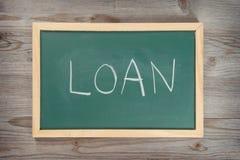 在黑板的贷款信件 库存照片