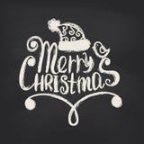 在黑板背景的圣诞快乐 库存照片
